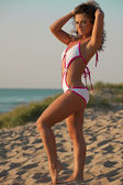Woman in bathing suit at the beach — Stock Photo