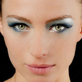 Beautiful woman with green eyes and blue makeup — Stock Photo
