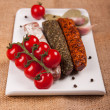 Stock Photo: Plate with sausages and tomatoes