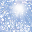 Vector of snowfall with sunlight rays on blue sky background - Stock Vector