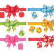 Stock Vector: Set of gift bows with ribbons and tags.