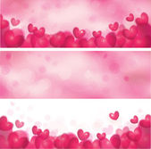 Pink banners with hearts. — Stock Vector