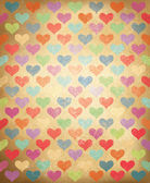 Vector grunge background with colorful hearts pattern. — Stock Vector