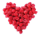 Red raspberries heart shape — Stock Photo