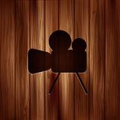 Video camera icon. Media symbol. Wooden texture. — Stock Vector