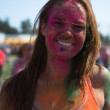 People celebrate Holi Festival Of Colors - Stock Photo