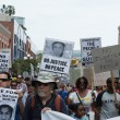 Protesters carried placards in support Trayvon and other victims of violence. — Stock Photo