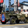 Stock Photo: jeep with world war ii veterans in the 73th annual nisei week gr