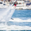 Unidentfied man demonstrates flyboard acrobatics in Long Beach — Stock Photo