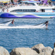 Stock Photo: Unidentfied mdemonstrates flyboard acrobatics in Long Beach
