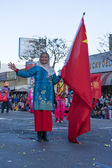 Asian Chinese woman with flag in the 115th Annual Golden Dragon — Stock Photo