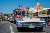 Motorcade in the 115th Annual Golden Dragon Parade — Stock Photo