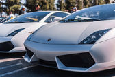 White Lamborghini on exhibition parking at an annual event Super — Stock Photo