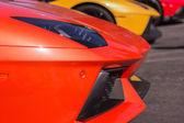 Orange Lamborghini on exhibition parking at an annual event Supe — Stock Photo