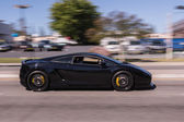 Black Lamborghini in the street — Stock Photo