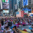 Thousands of New Yorkers practicing yoga in Times Square. — Stock Photo #48584097
