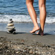 Pile of Stones and Female Legs — Stock Photo