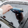 Stock Photo: Cleaning car windscreen