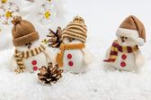 Snowmen in the snow — Stock Photo