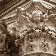 Angels heads on top of column in church — Stock Photo #40555995