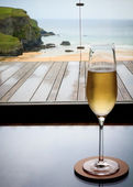 Glass of champagne in Cornwall — Stock Photo