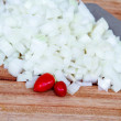 Fresh Diced Onion with Knife and Chillis — Stock Photo