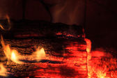 Glowing Log in a Dying Fire — Stock Photo