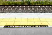 Warning Stay Behind the Yellow Line — Stock Photo