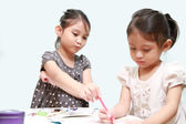 A Sister Tease Her Sister Doing Homework After School — Stock Photo