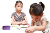 Ignorance Of Kid While Sister Doing Homework Patiently — Stock Photo