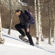 Man in snowshoes — Stock Photo
