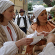 Stock Photo: Medieval market. Participants of medieval costume party