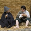 Stock Photo: Poor children in street. Participants of medieval costume party