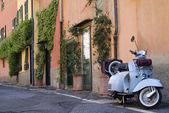 Scooter parked in the street — Stock Photo