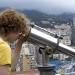 Tourist using coin telescope — Stock Photo