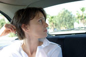 Woman in car — Foto de Stock