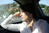Sad woman in car — Stock Photo