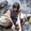 Woman by the river  — Stock Photo