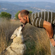 Man and his best friend purebred Czechoslovakian Wolf dog — Stock Photo
