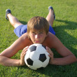 A young boy with a soccer ball — Stock Photo