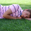 Boy laying on the green meadow — Stock Photo