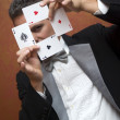 Magician performing with cards — Stock Photo #18862171