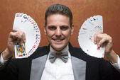 Magician performing with cards — Stock Photo