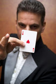 Magician performing with card — Stock Photo