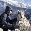 Stock Photo: Mwith dog hike in winter mountains