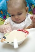 Baby being fed with baby food — Stock Photo