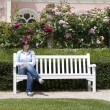 Woman sitting at bench — Stock Photo
