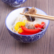 Mushroom in a chopstick — Stock Photo