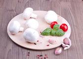 Field mushrooms, garlic, basil and tomatoes — Stock Photo