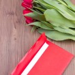 Red tulips and envelope — Stock Photo